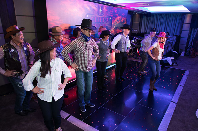 Line Dance Instructor - This was a Wild West themed birthday party organized by our event management company. We plan fun, themed annual dinners, anniversary parties, gala dinners and other events. Chunky Onion does the event planning, on-site management, decoration, entertainment, and audio-visual services.